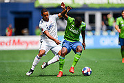 New England Revolution midfielder Brandon Bye (15) a nd Seattle Sounders defender Nouhou Tolo (5) battle for the ball during a MLS soccer game, Saturday, Aug. 10, 2019, in Seattle.  The teams played to a 3-3 tie. (Alika Jenner/Image of Sport)