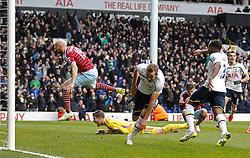 West Ham's Adrian lays on the floor screaming as Tottenham Hotspur's Harry Kane celebrates scoring a goal - Photo mandatory by-line: Mitchell Gunn/JMP - Mobile: 07966 386802 - 22/02/2015 - SPORT - football - London - White Hart Lane - Tottenham Hotspur v West Ham United - Barclays Premier League