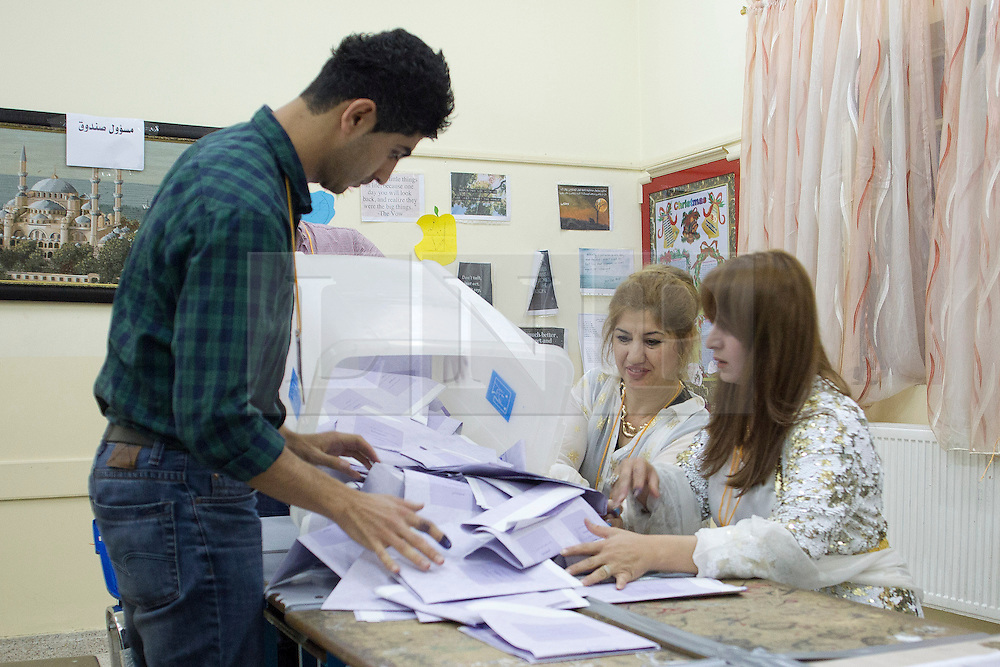 © Licensed to London News Pictures. 30/04/2014. Sulaimaniya, Iraq. Officials empty a ballot box so they can count how many votes were cast in a school used as a polling station after the 2014 Iraqi parliamentary elections in Sulaimaniya, Iraqi-Kurdistan today (30/04/2014). <br /> <br /> The period leading up to the elections, the fourth held since the 2003 coalition forces invasion, has already seen polling stations in central Iraq hit by suicide bombers causing at least 27 deaths. Photo credit: Matt Cetti-Roberts/LNP