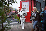 UNITED KINGDOM, London: 24 October 2015. <br /> Comic Con Feature.<br /> A cosplay fan dressed as a Storm Trooper from Star Wars stands at the entrance to a bar outside the MCM London Comic Con at the ExCel Arena in east London.<br /> Photo: Rick Findler / Story Picture Agency