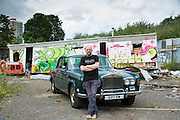 Gavin Turk, artist, photographed with his Rolls Royce on wasteland near his East London studio  -------COPYRIGHT - TIM GRAHAM. For permission to use  this image please contact mail@timgraham.co.uk