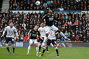 Bolton forward Emile Heskey challenges for the ball in the air during the Sky Bet Championship match between Derby County and Bolton Wanderers at the iPro Stadium, Derby, England on 9 April 2016. Photo by Aaron  Lupton.
