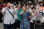 Crowds watch former professional wrestler, Antonio Inoki, campaigning for the right-wing Japan Restoration Party outside Shinjuku station, Tokyo, Japan. Friday July 19th 2013