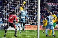 Photo: Daniel Hambury.<br />Coventry City v Norwich City. Coca Cola Championship.<br />26/11/2005.<br />Norwich's Calum Davenport (2nd, L) scores.