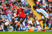 Manchester United Women midfielder Hayley Ladd (12) passes the ball during the FA Women's Super League match between Manchester City Women and Manchester United Women at the Sport City Academy Stadium, Manchester, United Kingdom on 7 September 2019.