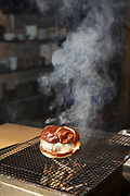 NEW YORK, NY - November  8, 2017:  A hamburger prepared by Chef Masa Takayama in the basement grill at Tetsu, the chef's new casual restaurant in TriBeCa.<br /> <br /> CREDIT: Clay Williams for The New York Times.<br /> <br /> &copy; Clay Williams / claywilliamsphoto.com