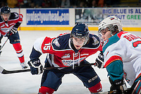 KELOWNA, CANADA - MARCH 23: Rodney Southam #15 of the Tri-City Americans faces off against Tyson Baillie #24 of the Kelowna Rockets on March 23, 2014 at Prospera Place in Kelowna, British Columbia, Canada.   (Photo by Marissa Baecker/Shoot the Breeze)  *** Local Caption *** Rodney Southam; Tyson Baillie;