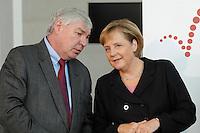 """16 OCT 2006, BERLIN/GERMANY:<br /> Michael Sommer (L), Vorsitzender Deutscher Gewerkschaftsbund, DGB, und Angela Merkel (R), CDU, Bundeskanzlerin, im Gespraech, waehrend einer Pressekonferenz nach dem Spitzengespraech """"Familie und Wirtschaft"""" der Bundeskanzlerin mit der Impulsgruppe der """"Allianz für die Familie"""", Bundeskanzleramt<br /> IMAGE: 20061016-01-032<br /> KEYWORDS: Spitzengespräch, Gespräch"""