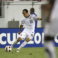 USA midfielder Landon Donovan (10) kicks the ball on a free kick during a CONCACAF Gold Cup soccer match between the United States and Panama on Saturday, June 11, 2011, at Raymond James Stadium in Tampa, Fla. (AP Photo/Alex Menendez)