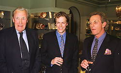 Left to right, MAJOR BRUCE SHAND, MR TOM PARKER BOWLES and MR MARK SHAND, at a party in London on 13th October 1998.MKT 150
