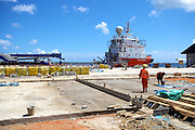 Local employees working at the port in Mtwara, Tanzania...Mtwara is under going a lot of growth due in part to the investment of oil companies in the area...VSO is working in partnership with BG group and VETA, a local vocational training centre, to help train local people so as they can find employment.