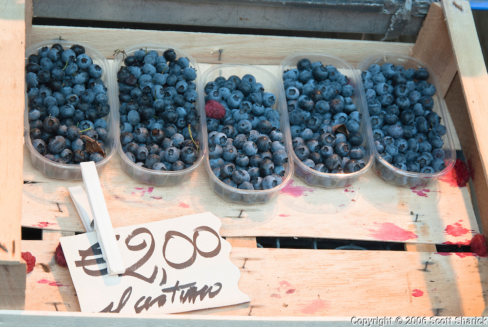 Blueberries for sale along the streets of a small Italian town.