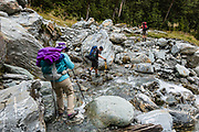 Crossing a side stream on the Rees-Dart Track in Dart Valley on the descent to Daley's Flat Hut. In 5 days, we tramped the strenuous Rees-Dart Track for 39 miles plus 12.5 miles side trip to spectacular Cascade Saddle, in Mount Aspiring National Park, Otago region, South Island of New Zealand.