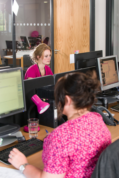 Team manager Lindsey Jefferson and Property & Services Team , at work in the new Waverely Housing offices in Hawick.