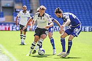 Lasse Vigen Christensen takes on the Cardiff City defence  during the Sky Bet Championship match between Cardiff City and Fulham at the Cardiff City Stadium, Cardiff, Wales on 8 August 2015. Photo by Shane Healey.