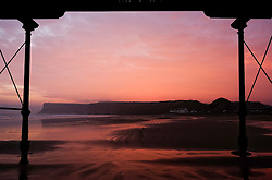 © Licensed to London News Pictures.28/10/15<br /> Saltburn, UK. <br /> <br /> Framed by the Victorian pier stunning colours light up the morning sky over the cliffs at Saltburn in Cleveland. <br /> <br /> Photo credit : Ian Forsyth/LNP