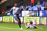 Wycombe Wanderers defender Anthony Stewart  fouls the opponent during the EFL Sky Bet League 1 match between Bolton Wanderers and Wycombe Wanderers at the University of  Bolton Stadium, Bolton, England on 15 February 2020.