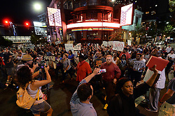 September 23, 2016 - Charlotte, NC, USA - Protesters march down College Street in Charlotte, N.C., on Friday, Sept. 23, 2016, as demonstrations continue following the shooting death of Keith Scott by police earlier in the week. (Credit Image: © Jeff Siner/TNS via ZUMA Wire)