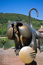 Bronze sculpture of monkey or Brueckenaffe on Karl-Theodor Bridge, crossing the Neckar River Heidelberg in Baden Württemberg in Germany