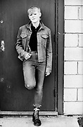 Tina posing in denim clothes, High Wycombe, UK, 1980s.