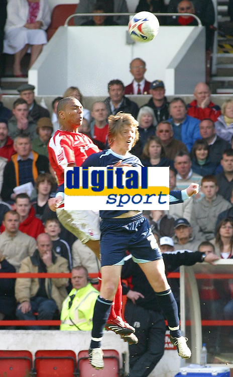 Photo: Dave Linney.<br />Nottingham Forest v Bournemouth. Coca Cola League 1. 29/04/2006.Forest's Julian Bennett(L) beats Adam Griffiths to the ball