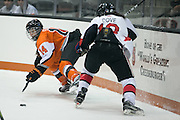 RIT's Mackenzie Stone keeps a puck away from defenders during an exhibition game at RIT's Gene Polisseni Center on Monday, September 29, 2014.