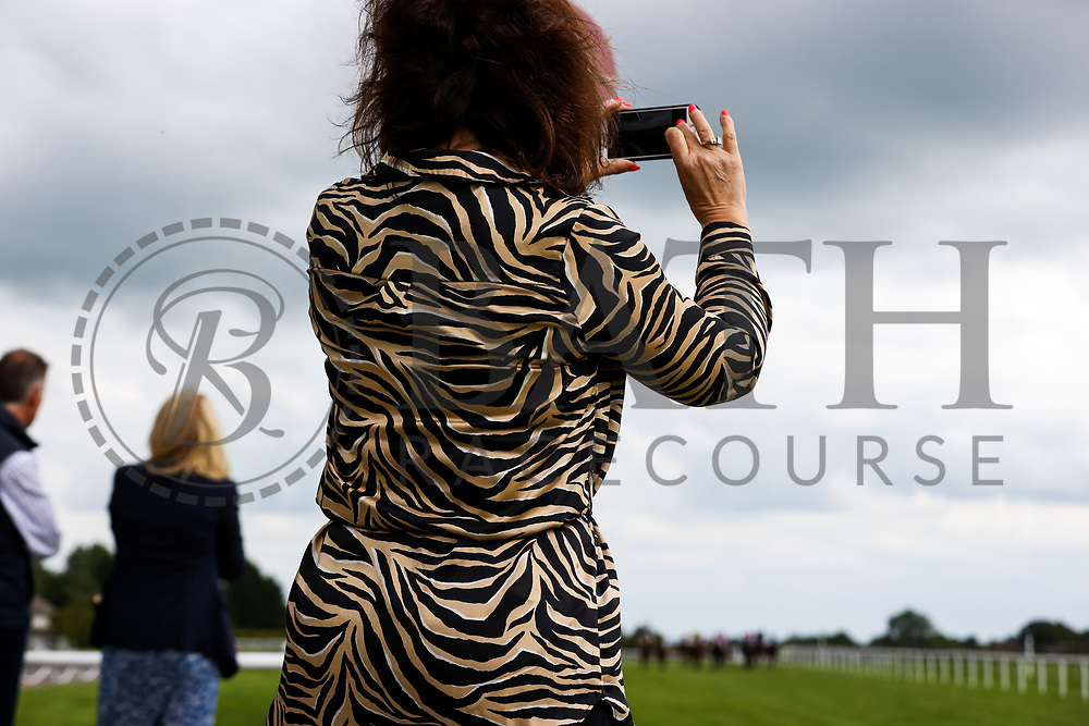 Owners watch on as Air of York ridden by Megan Nicholls (T: Grace Harris) wins the 14:35 Home Of Winners At valuerater.co.uk Handicap (Div 1) - Rogan/JMP - 14/07/2020 - HORSE RACING - Bath Racecourse - Bath, England.