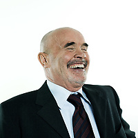 studio portrait isolated on white background of a man senior