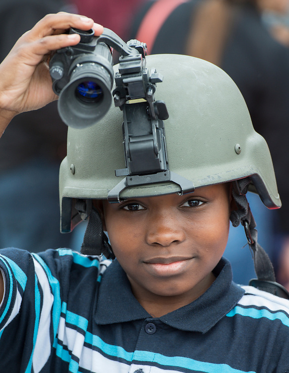 A student checks out the Houston Metro Police exhibit at the When I Grow Up fair, March 8, 2014.