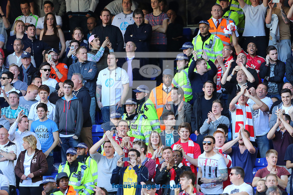 Police and stewards make a barrier between fans of Tottenham Hotspur and Arsenal during the Barclays Premier League match at White Hart Lane, London<br /> Picture by Richard Calver/Focus Images Ltd +447792 981244<br /> 16/03/2014