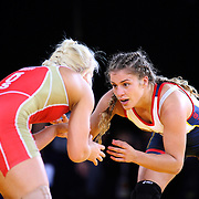 Women wrestlers Helen Maroulis, USA, (blue) in action against Irina Kisel, Russia, (red) as wrestlers from USA, Iran and Russia compete at Grand Central Terminal as part of the Beat the Streets Gala. Billed ?The Rumble On The Rails,? the international wrestling event showcased competition as part of World Wrestling Month. Vanderbilt Hall, Grand Central Station, Manhattan,New York. USA. 15th May 2013. Photo Tim Clayton
