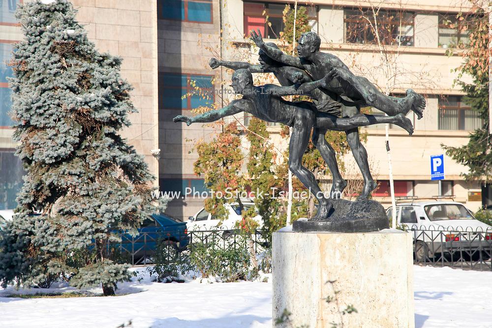 Three Men Running Statue On Calea Victoriei, Bucharest, Romania