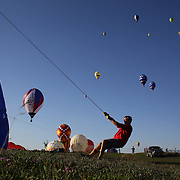 Hot Air balloons in the skies around rural Michigan near Battle Creek as they reach a target area during competition in the 20th FAI World Hot Air Ballooning Championships. Battle Creek, Michigan, USA. 22nd August 2012. Photo Tim Clayton4