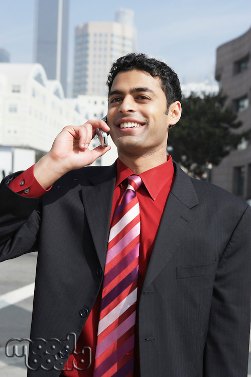 Businessman Using Cell Phone Downtown