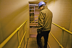 Business Operations Director Jay Anast, for California Dry Dock Solutions walks through the underground water pumping station for the Mare Island dry docks prior to the arrival of the Solon Turman,  California Dry Dock Solutions was recently awarded a $3.1 Million contract from the U.S.Navy to dismantle two ships currently located in Suisun Bay