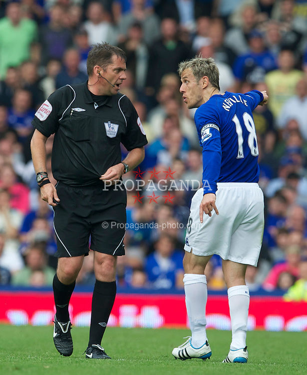 LIVERPOOL, ENGLAND - Saturday, May 7, 2011: Everton's captain Phil Neville argues with referee Phil Dowd during the Premiership match against Manchester City at Goodison Park. (Photo by David Rawcliffe/Propaganda)