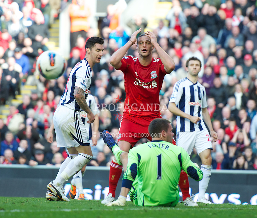 LIVERPOOL, ENGLAND - Sunday, April 22, 2012: Liverpool's Andy Carroll looks dejected after missing a chance against West Bromwich Albion during the Premiership match at Anfield. (Pic by David Rawcliffe/Propaganda)