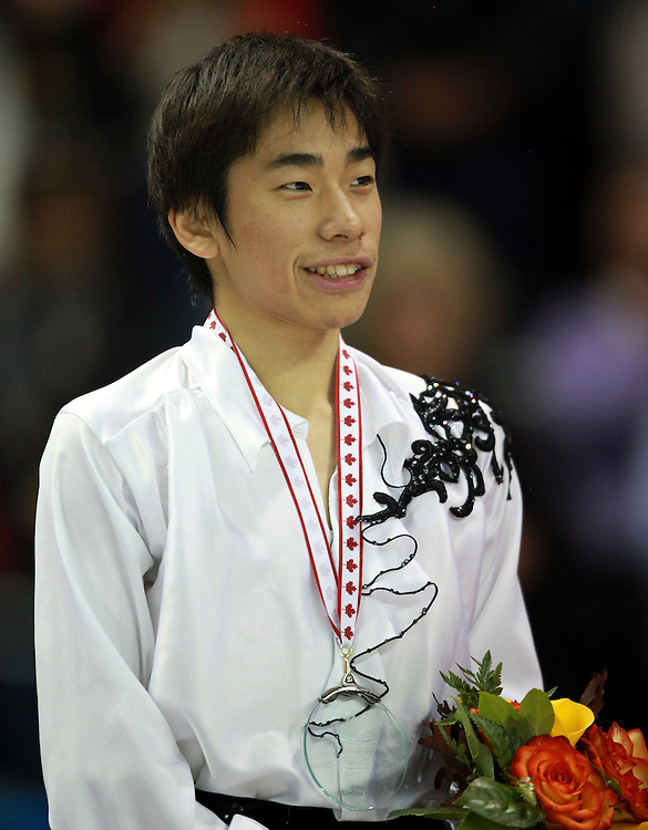 20101030 -- Kingston, Ontario -- Silver medalist Nobunari Oda of Japan smiles during the medal ceremony for the mens competition at Skate Canada International in Kingston, Ontario, Canada, October 30, 2010. <br /> AFP PHOTO/Geoff Robins