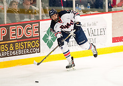 March 13 2016: Robert Morris Colonials forward Daniel Leavens (26) makes a pass out of his own during the first period in game three of the Atlantic Hockey quarterfinals series between the Bentley Falcons and the Robert Morris Colonials at the 84 Lumber Arena in Neville Island, Pennsylvania (Photo by Justin Berl)