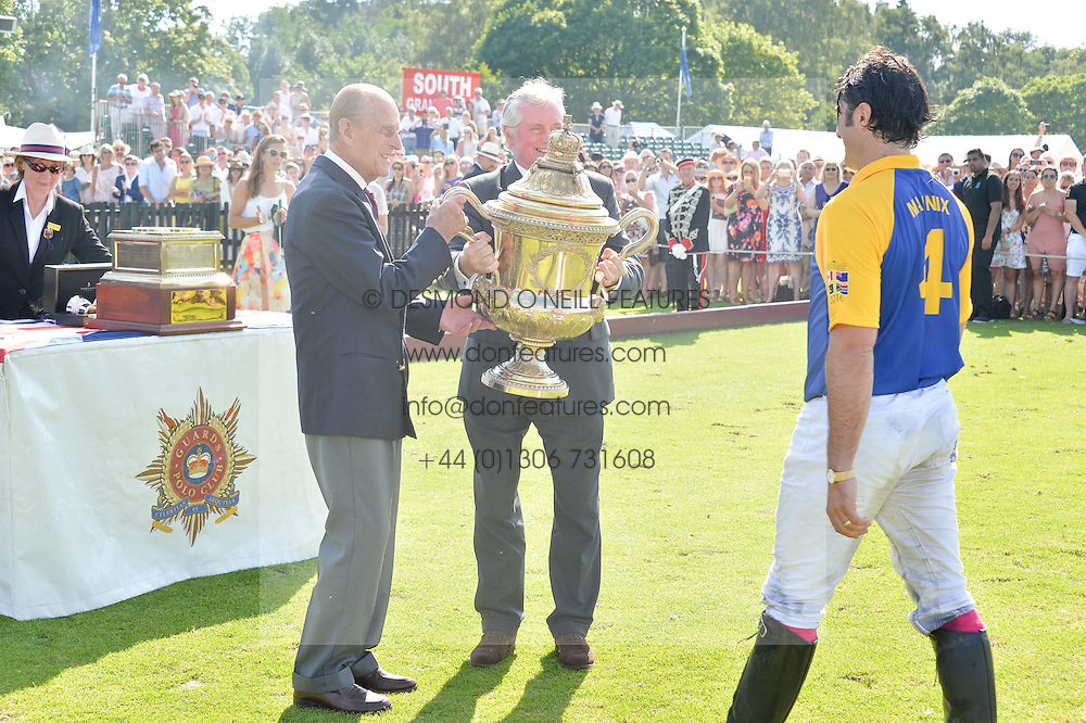 HRH The DUKE OF EDINBURGH with STEPHEN HUTCHINSON  chairman of the Hurlingham Polo Association presents the Coronation Cup to FRED MANNIX captain of the victorious Commonwealth team at The Royal Salute Coronation Cup Polo held at Guards Polo Club,  Smiths Lawn, Windsor Great Park, Egham on 23rd July 2016.