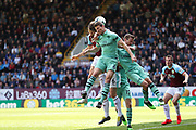 Burnley defender Ben Mee (6) heads the ball in front of Arsenal defender Laurent Koscielny (6) and Arsenal defender Nacho Monreal (18) during the Premier League match between Burnley and Arsenal at Turf Moor, Burnley, England on 12 May 2019.