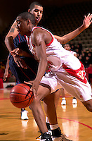 VMI's Reggie Williams drives the baseline guarded by Radford's Chris Oliver