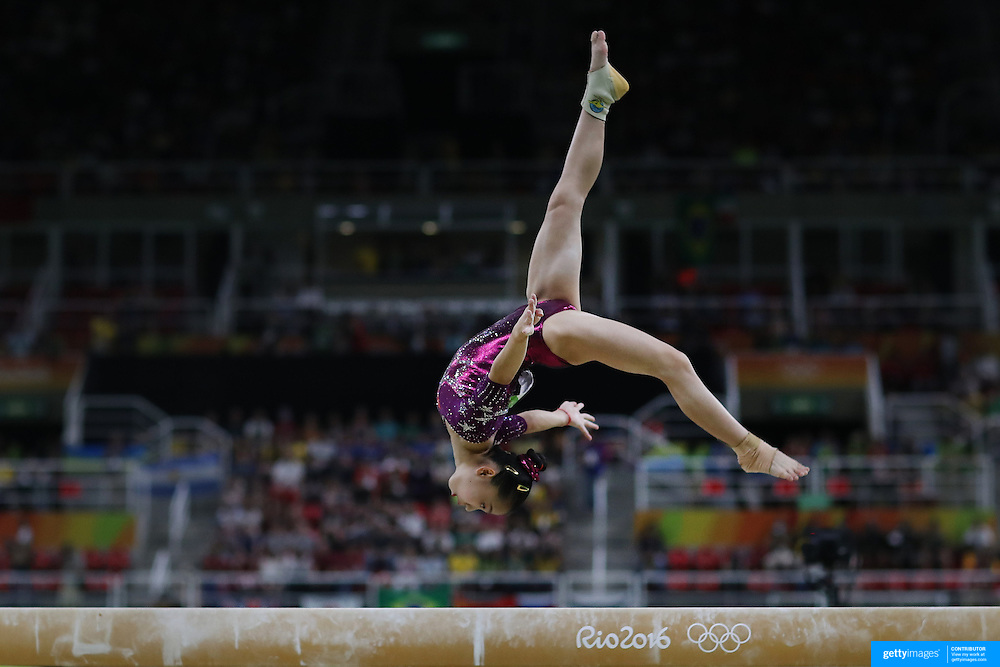 Gymnastics - Olympics: Day 4   Yan Wang of China performing her routine on the Balance Beam during the Artistic Gymnastics Women's Team Final at the Rio Olympic Arena on August 9, 2016 in Rio de Janeiro, Brazil. (Photo by Tim Clayton/Corbis via Getty Images)