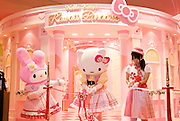 Staff dressed in Hello Kitty and Hello Melody costume cut the tape to mark the opening of Hello Kitty's Kawaii (Cute) Paradise, a Hello Kitty theme store, in Tokyo, Japan on Thursday 21 October  2010. .Photographer: Robert Gilhooly