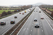 Traffic driving in winter on the M5 motorway near Bridgwater, Somerset, England looking north