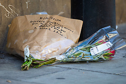 """Floral tributes to """"Tesfa"""" lie on the road near the scene where a man in his 40s was stabbed on Latchmere Road in Battersea in the afternoon of July 3rd 2019, dying later that evening in hospital. London, July 04 2019."""