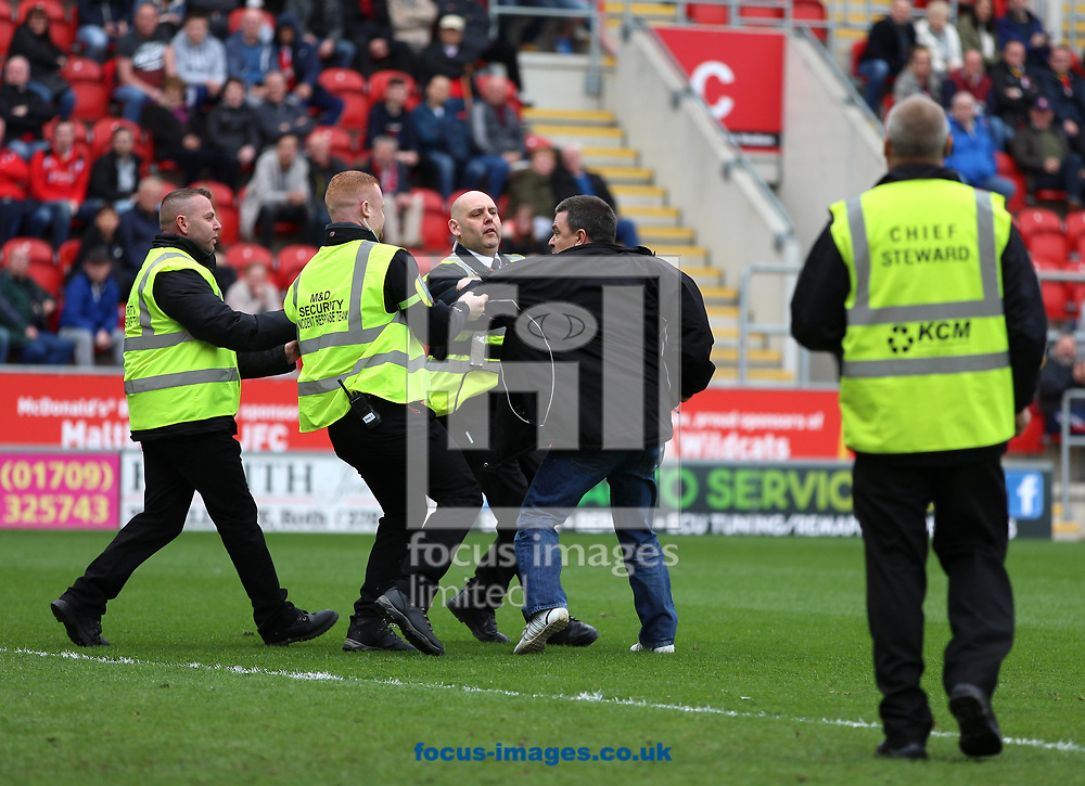 A Rotherham United fan invades the pitch and is tackled by stewards after Fulham take the lead during the Sky Bet Championship match at the New York Stadium, Rotherham<br /> Picture by James Wilson/Focus Images Ltd 07709 548263<br /> 01/04/2017