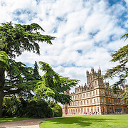 Highclere Castle, UK. Highclere Castle, in Hampshire, is the home of the Earl and Countess of Carnarvon and is used in the filming of the British TV series Downton Abbey.