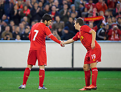 MELBOURNE, AUSTRALIA - Wednesday, July 24, 2013: Liverpool's Luis Suarez celebrates setting up the second goal against Melbourne Victory with team-mate Stewart Downing during a preseason friendly match at the Melbourne Cricket Ground. (Pic by David Rawcliffe/Propaganda)