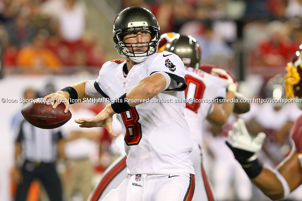 29 AUG 2013:    Mike Glennon (8) of the Buccaneers looks to pass during the NFL pre-season game between the Washington Redskins and the Tampa Bay Buccaneers at Raymond James Stadium in Tampa, Florida.